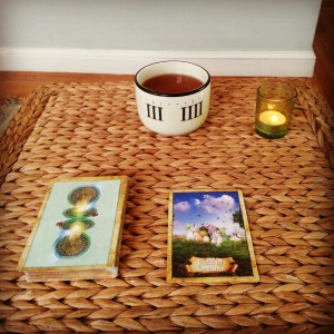 My ritual of tea, lighting a candle, and pulling a card
