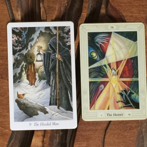 The Hooded Man from The Wildwood Tarot and The Hermit from the Thoth Tarot